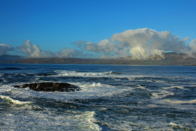 Looking over rough seas to dramatic clouds.