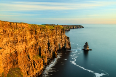 One of Ireland's most visited and well known landscapes; the Cliffs of Moher in Co. Clare, in golden evening light.